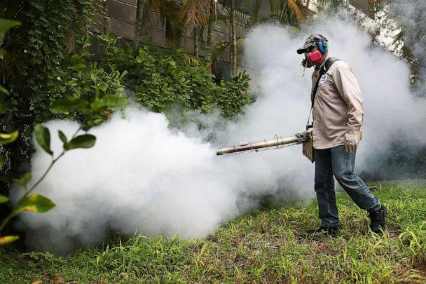 PHOTO: A Miami-Dade County mosquito control inspector sprays pesticide to kill mosquitoes in the Miami Beach neighborhood on Aug. 24, 2016 in Miami Beach, Fla. (Joe Raedle/Getty Images, FILE)