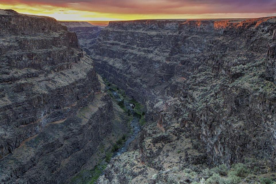"""<p>Hit the road to the Bruneau Canyon Overlook, which shows dazzling vistas of a remote 800-foot-deep river canyon that goes for about 60 miles. It's especially more impressive for its desert surroundings. (Flickr photo by <a href=""""https://flic.kr/p/F5mVSf"""" rel=""""nofollow noopener"""" target=""""_blank"""" data-ylk=""""slk:Bureau of Land Management"""" class=""""link rapid-noclick-resp"""">Bureau of Land Management</a><span class=""""redactor-invisible-space"""">)</span></p>"""