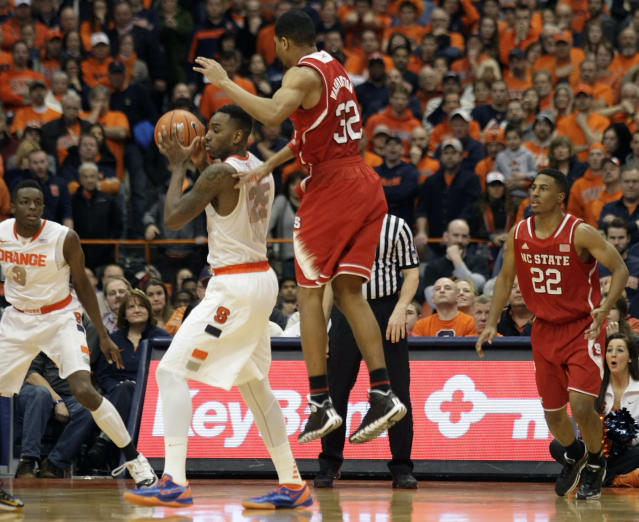 Syracuse's Rakeem Christmas, center left, steals the ball from North Carolina State's Kyle Washington, center right, to set up the winning basket with seconds left in the second half of an NCAA college basketball game in Syracuse, N.Y., Saturday, Feb. 15, 2014. Syracuse won 56-55. (AP Photo/Nick Lisi)