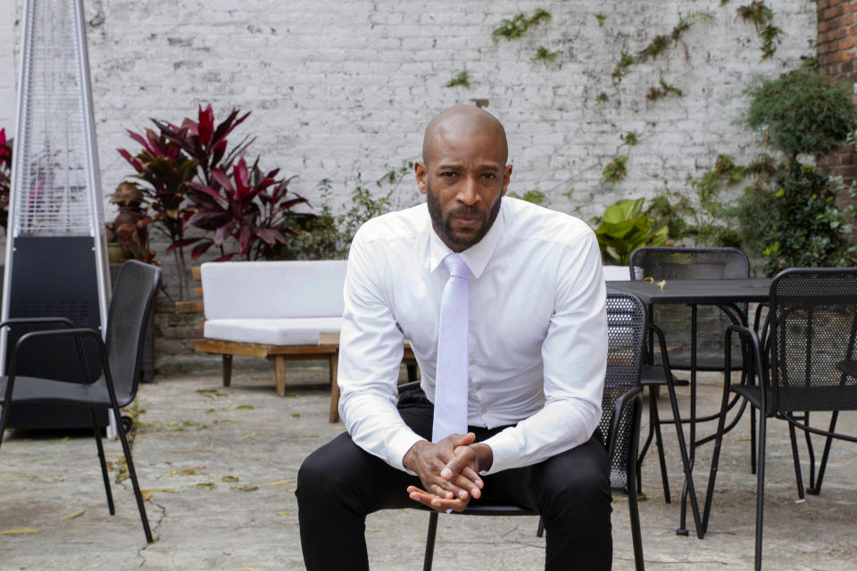 DJ Johnson poses for a portrait in New Orleans, Saturday, Jan. 30, 2021. Johnson's business — NOLA Art Bar — opened just six weeks before the pandemic-related shutdowns last March. It's been a struggle, but he's still open nearly a year later. (AP Photo/Dorthy Ray)