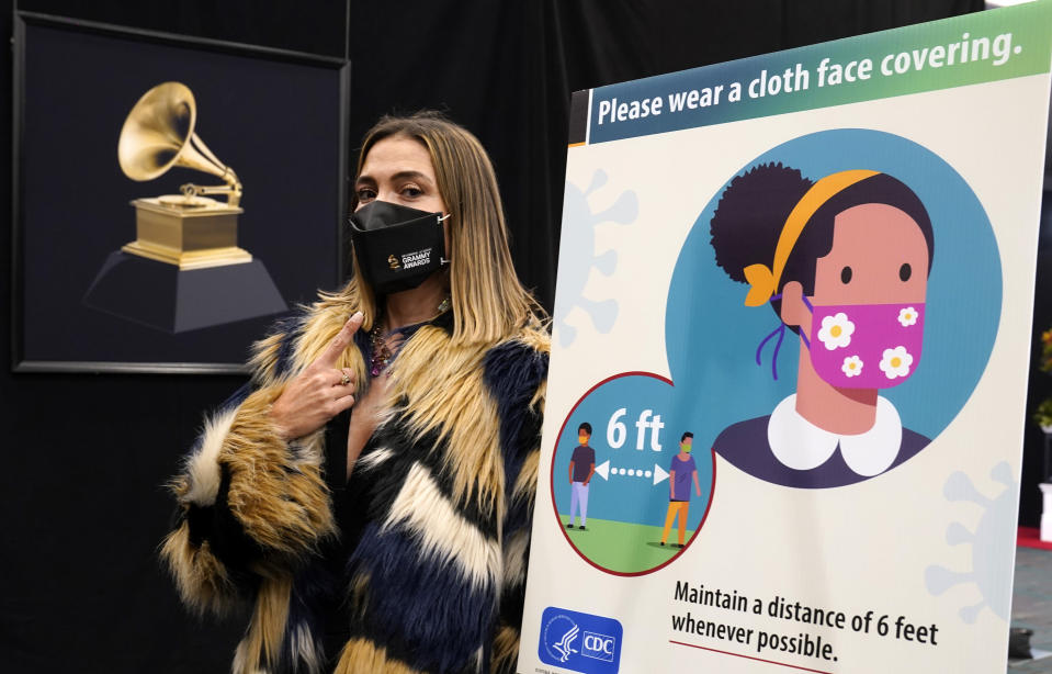 Associated Press entertainment reporter Marcela Isaza poses backstage at the 63rd Grammy Awards at the Los Angeles Convention Center, Thursday, March 11, 2021. The awards show will air on Sunday. (AP Photo/Chris Pizzello)