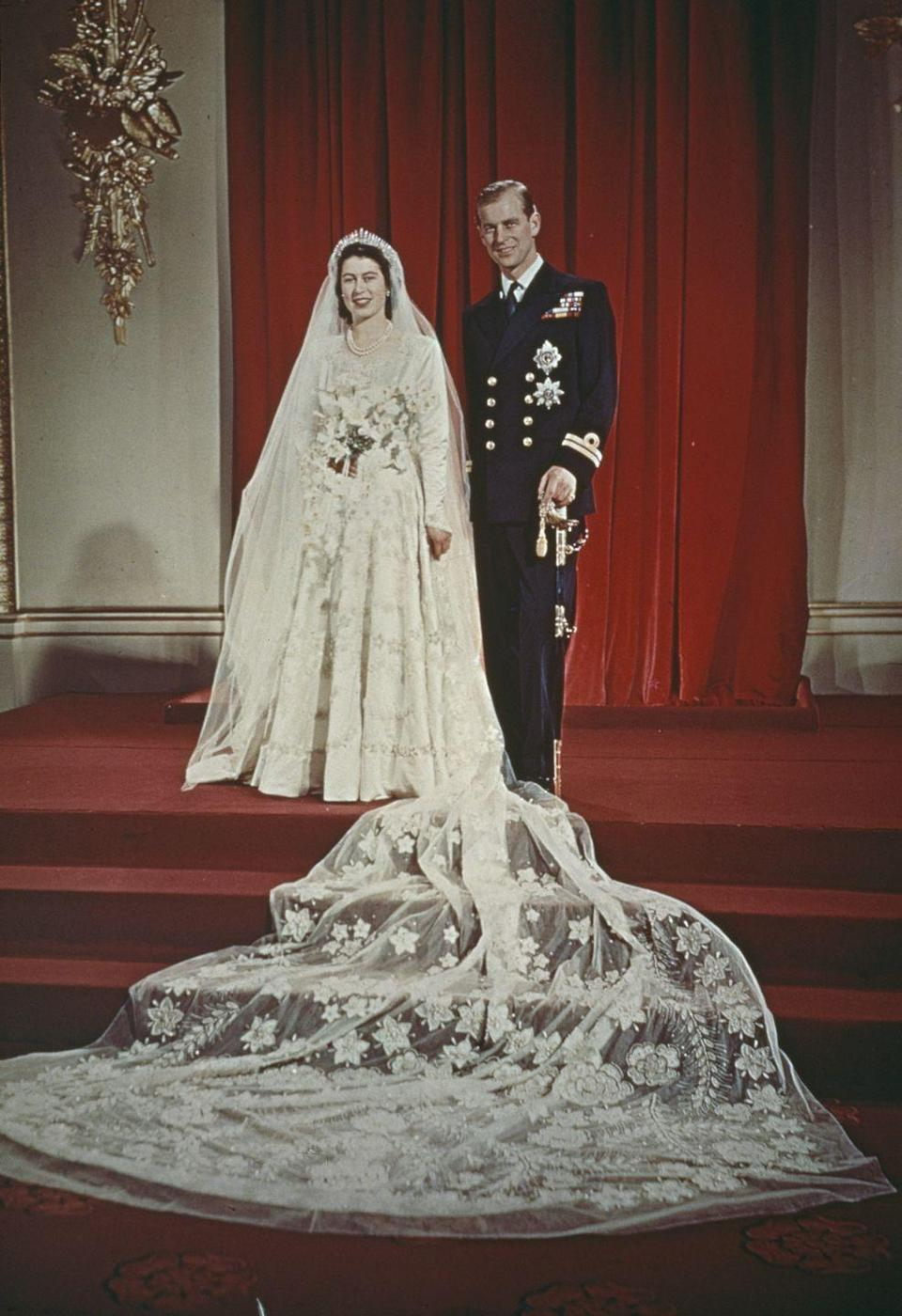"""<p>At just 21 years old, Princess Elizabeth said """"I do"""" to the newly-dubbed Prince Philip, Duke of Edinburgh, at Westminster Abbey on November 20. She wore a gown designed by Norman Hartnell. It was a great celebration for the country, still reeling from the aftermath of World War II, which ended just two years before. After the nuptials, they honeymooned in Malta, where Philip, 26, was stationed with the Royal Navy.</p>"""