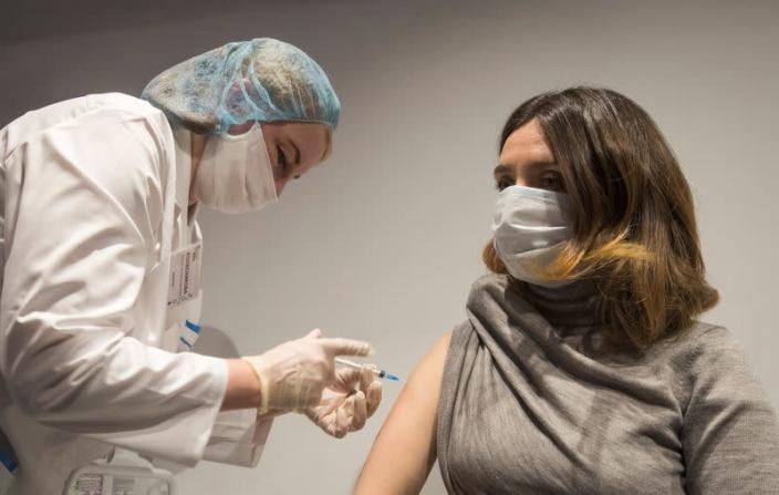 A woman receives an injection with Sputnik V (Gam-COVID-Vac) vaccine against the coronavirus disease (COVID-19) in Moscow