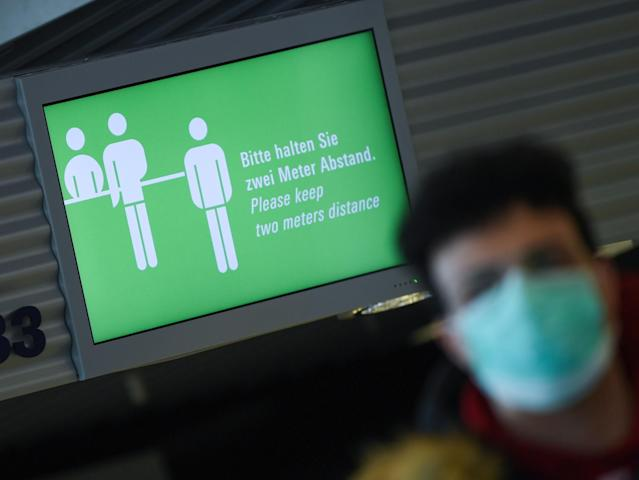 A man is pictured wearing a mask at Frankfurt airport on 23 March. Germany has had more than 27,500 confirmed cases. (Getty Images)