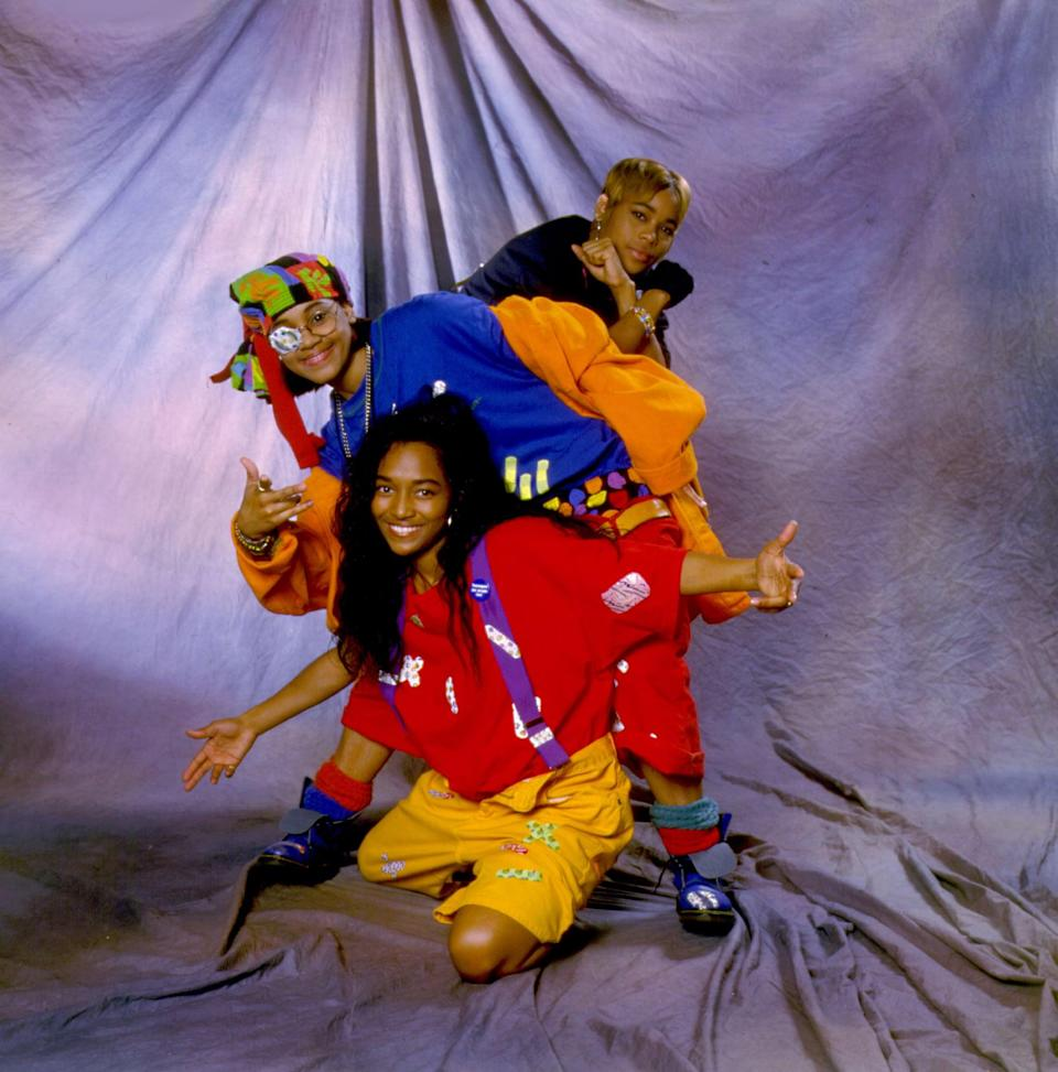 """<p>To pull off Tionne """"T-Boz"""" Watkins, Lisa """"Left Eye"""" Lopes, and Rozonda """"Chilli"""" Thomas of the R&amp;B group TLC, you'll need bright, baggy clothes, caps turned backward, suspenders, and either a patch or a black mark under the eye of whoever's Left Eye. Going around singing """"Waterfalls"""" is optional but advised.</p>"""