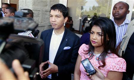 Madagascar's President Rajoelina flanked by his wife Mialy address the media after casting their ballots at a polling centre in Ambatobe