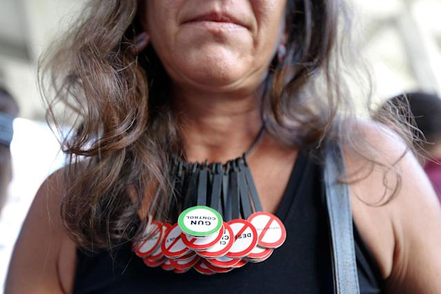 "<p>Alessandra Mondolfi wears a necklace that reads ""GUN CONTROL"" during a protest against guns on the steps of the Broward County Federal courthouse in Fort Lauderdale, Fla., on Saturday, Feb. 17, 2018. (Photo: Brynn Anderson/AP) </p>"