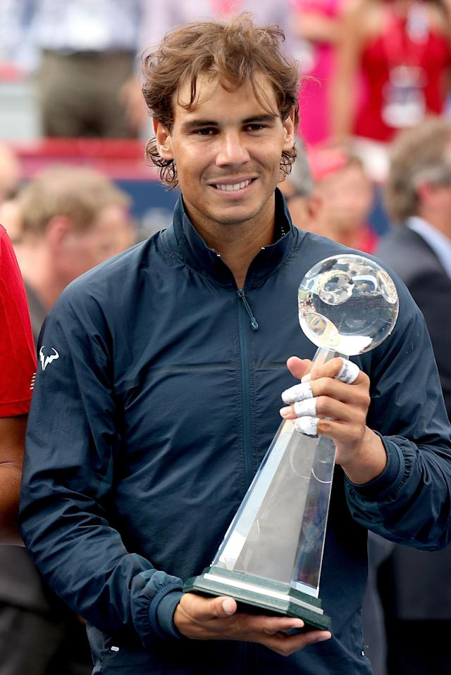 MONTREAL, QC - AUGUST 11: Rafael Nadal of Spain poses for photographers after defeating Milos Roanic of Canada during the final of the Rogers Cup at Uniprix Stadium on August 11, 2013 in Montreal, Quebec, Canada. (Photo by Matthew Stockman/Getty Images)