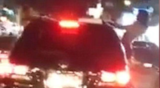 The two females can be seen in the footage hanging out of the moving vehicle. Source: Facebook.