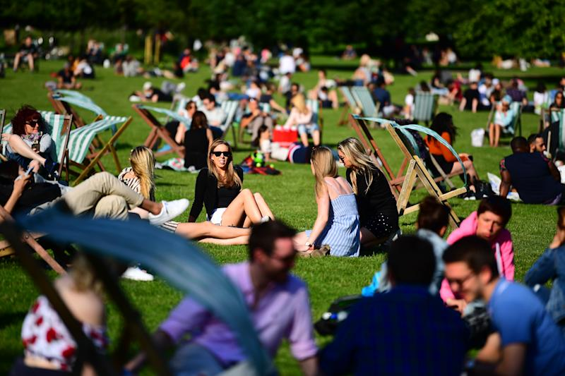 People enjoying the hot weather in St James's Park in London. (Picture: PA/Getty)
