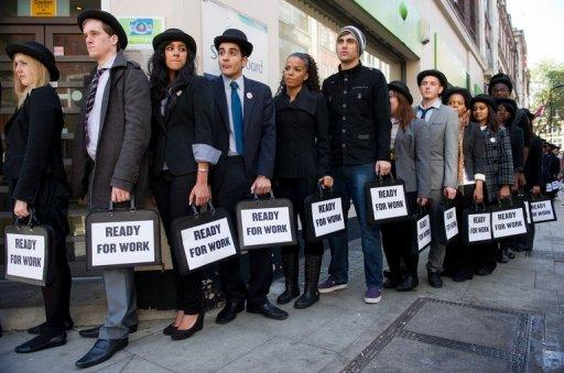 File photo shows people outside a job centre in London taking part in a campaign to draw attention to the high numbers of unemployed young people in Britain. Youth joblessness is almost back at its peak following the outbreak of the global economic crisis and is unlikely to ease until at least 2016, the International Labour Organization warned Tuesday