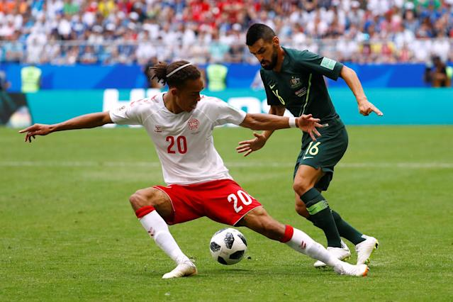 Soccer Football - World Cup - Group C - Denmark vs Australia - Samara Arena, Samara, Russia - June 21, 2018 Denmark's Yussuf Poulsen in action with Australia's Aziz Behich REUTERS/Michael Dalder