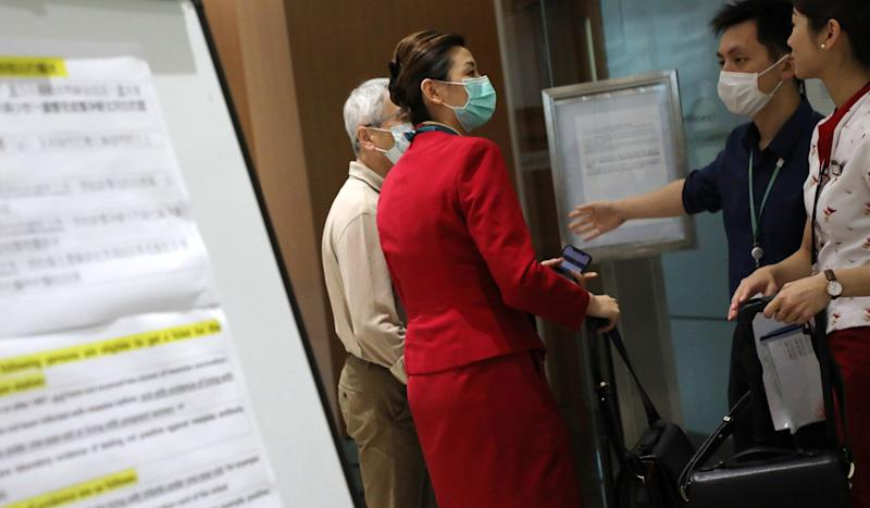 Filipino helpers to be given measles immunity tests at Hong Kong airport in bid to stem further outbreak but some call the measure discriminatory