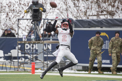 UNLV wide receiver Mekhi Stevenson (2) makes a catch in the end zone for a touchdown against Nevada in the first half of an NCAA college football game in Reno, Nev., Saturday, Nov. 30, 2019. (AP Photo/Tom R. Smedes)