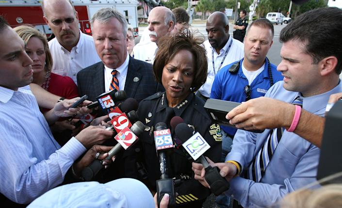 Demings at the scene of a mass shooting in Orlando's Gateway Center in 2009 | Joe Burbank—Orlando Sentinel