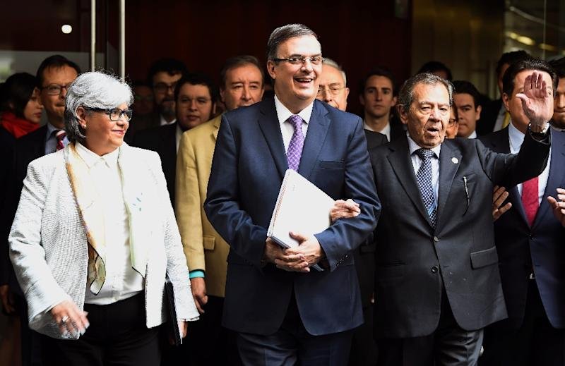 Mexican Foreign Minister Marcelo Ebrard (C) has asked the UN for a special envoy to coordinate efforts to stem the flow of migrants from Central America
