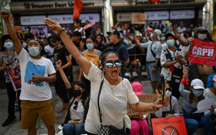 Protesters take part in a demonstration against the military coup in Yangon - YE AUNG THU/AFP