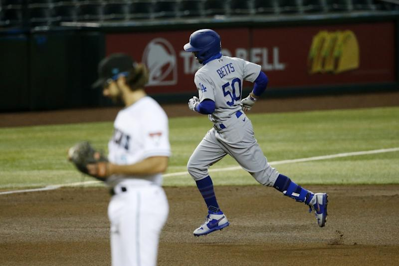 The Dodgers' Mookie Betts rounds the bases after hitting a home run against the Diamondbacks on July 31, 2020.