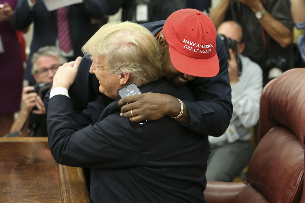 Trump hugs West during their meeting in the Oval Office. (Photo: Oliver Contreras/Pool/Getty Images)