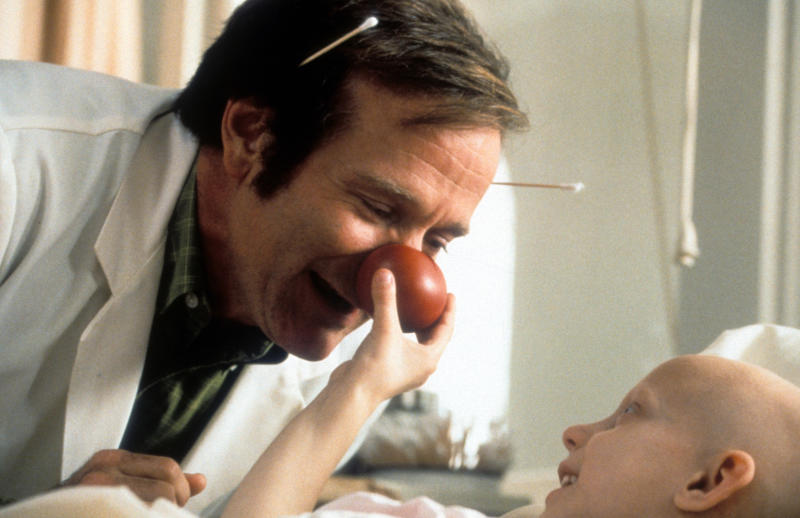 Robin Williams visits a sick child in a scene from the film 'Patch Adams', 1998. (Photo by Universal/Getty Images)