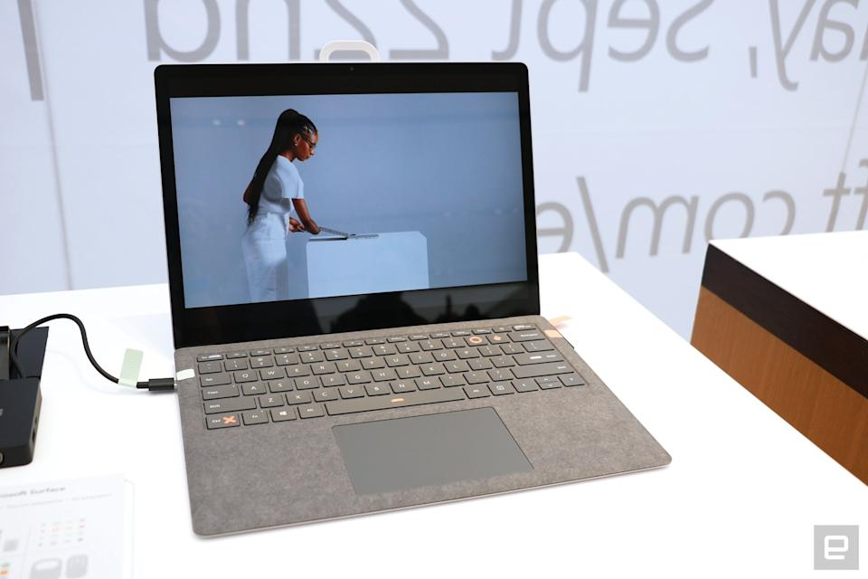 <p>An off-angle shot of the Surface Pro with labels and stickers from the Adaptive Kit attached to its charging cables and space bar, left control key and the P and O buttons.</p>