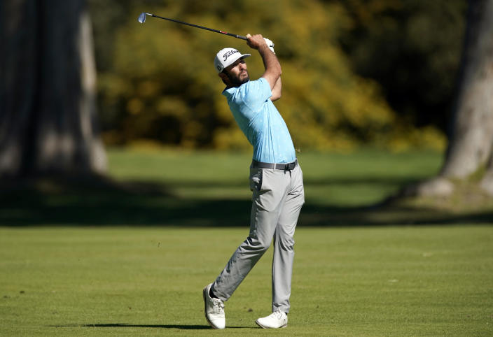 Max Homa hits his second shot on the 13th hole during the final round of the Genesis Invitational golf tournament at Riviera Country Club, Sunday, Feb. 21, 2021, in the Pacific Palisades area of Los Angeles. (AP Photo/Ryan Kang)
