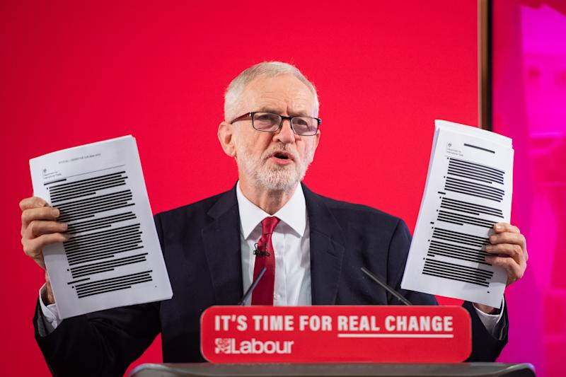 Labour leader Jeremy Corbyn holds redacted copies of the Department for International Trade's UK-US Trade and Investment Working Group report following a speech about the NHS, in Westminster, London.