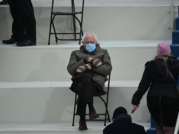 Former presidential candidate, Senator Bernie Sanders (D-Vermont) sits in the bleachers on Capitol Hill before Joe Biden is sworn in as the 46th US President on January 20, 2021, at the US Capitol in Washington, DC. (Photo by Brendan SMIALOWSKI / AFP) (Photo by BRENDAN SMIALOWSKI/AFP via Getty Images)