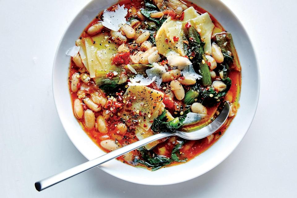 """Plenty of garlic and Parmesan give a nice punch of flavor to this hearty vegetarian dinner. <a href=""""https://www.epicurious.com/recipes/food/views/pasta-e-fagioli-with-escarole?mbid=synd_yahoo_rss"""" rel=""""nofollow noopener"""" target=""""_blank"""" data-ylk=""""slk:See recipe."""" class=""""link rapid-noclick-resp"""">See recipe.</a>"""