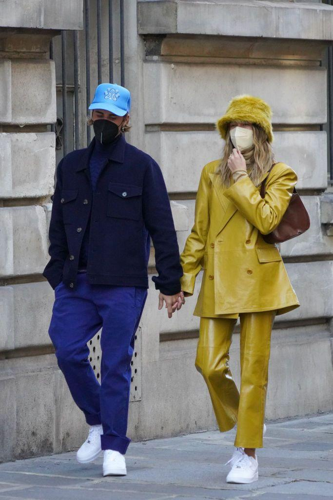 """<p>While out in Paris (we're presuming for <a href=""""https://www.elle.com/uk/paris-fashion-week/"""" rel=""""nofollow noopener"""" target=""""_blank"""" data-ylk=""""slk:Paris Fashion Week"""" class=""""link rapid-noclick-resp"""">Paris Fashion Week</a>), the Biebers clashed in colour-drenched outfits. Justin wore all blue, while Hialey paired a mustard furry hat with matching shiny suit, both by Stand Studio with a handbag by By Far. They both wore crisp white Nike Air Force 1s.</p><p><a class=""""link rapid-noclick-resp"""" href=""""https://go.redirectingat.com?id=127X1599956&url=https%3A%2F%2Fwww.net-a-porter.com%2Fen-gb%2Fshop%2Fdesigner%2Fstand-studio%2Fclothing&sref=https%3A%2F%2Fwww.elle.com%2Fuk%2Ffashion%2Fcelebrity-style%2Farticles%2Fg31247%2Fhailey-baldwin-fashion-style-file%2F"""" rel=""""nofollow noopener"""" target=""""_blank"""" data-ylk=""""slk:SHOP STAND STUDIO NOW"""">SHOP STAND STUDIO NOW</a></p>"""