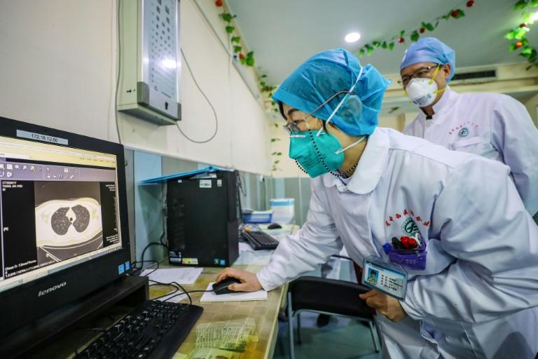 Two weeks ago Chinese doctors confirmed they had been giving anti-HIV drugs to coronavirus patients in Beijing (AFP Photo/STR)