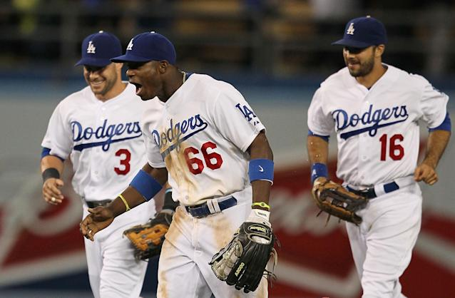 LOS ANGELES, CA - JUNE 24: Skip Schumaker #3, Yasiel Puig #66 and Andre Ethier #16 of the Los Angeles Dodgers react after defeating the San Francisco Giants 3-1 in their MLB game at Dodger Stadium on June 24, 2013 in Los Angeles, California. (Photo by Victor Decolongon/Getty Images)