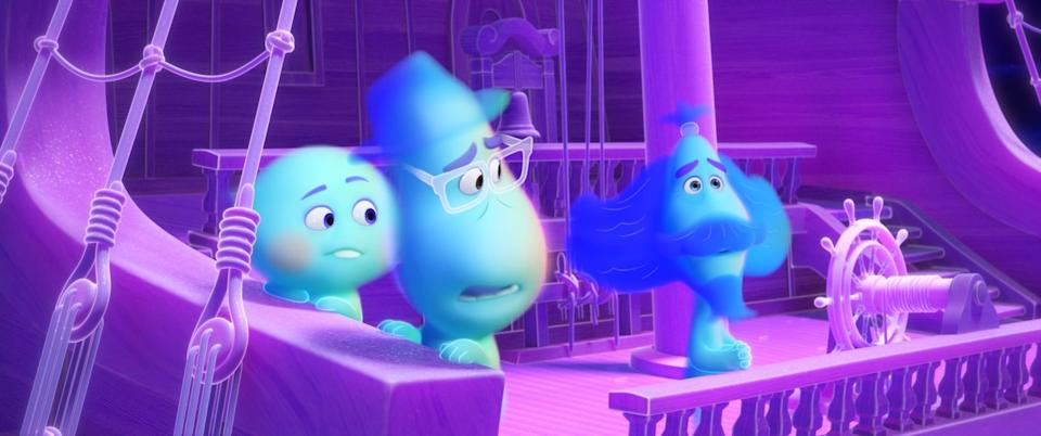 """Middle-school band teacher Joe Gardner (voiced by Jamie Foxx, center) journeys through the afterlife and meets a precocious soul (Tina Fey) and a spiritual sign twirler (Graham Norton) in Disney/Pixar's """"Soul."""""""