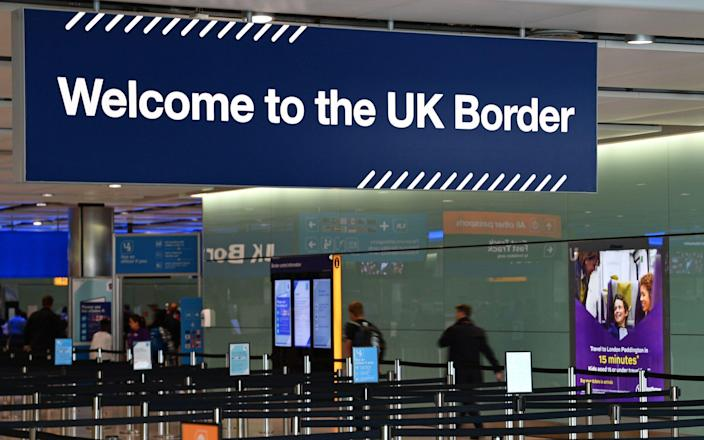 Analysis by Migration Watch reveals that 4.8 per cent of 1.9 million people who came to UK on work or study visas did not leave on time - Daniel Leal-Olivas/ AFP