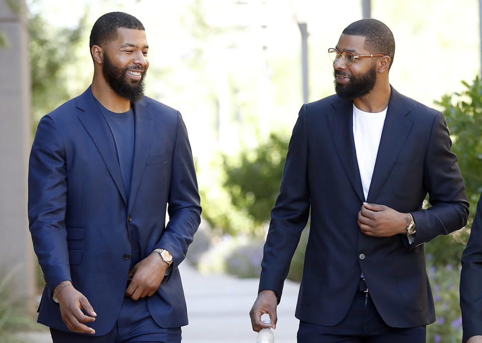 Morris twins Markieff (left) and Marcus were acquitted of the aggravated assault charge against them. (AP)