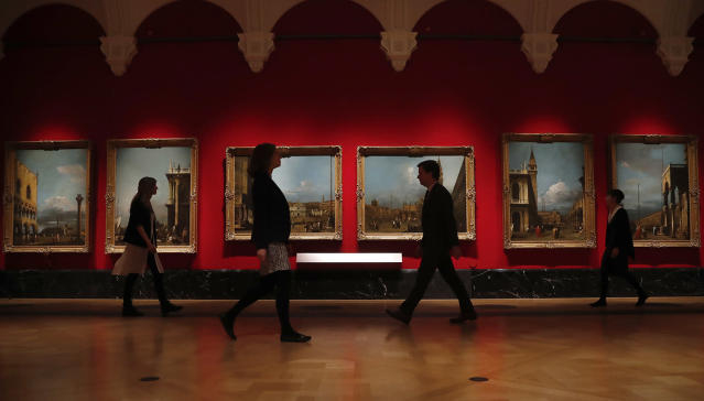 <p>People walk past Canaletto's paintings of Venice views at the Queen's Gallery at Buckingham Palace in London, May 18, 2017. Canaletto & the Art of Venice is opening on May 19 at the Queen's Gallery, Buckingham Palace. (Photo: Frank Augstein/AP) </p>