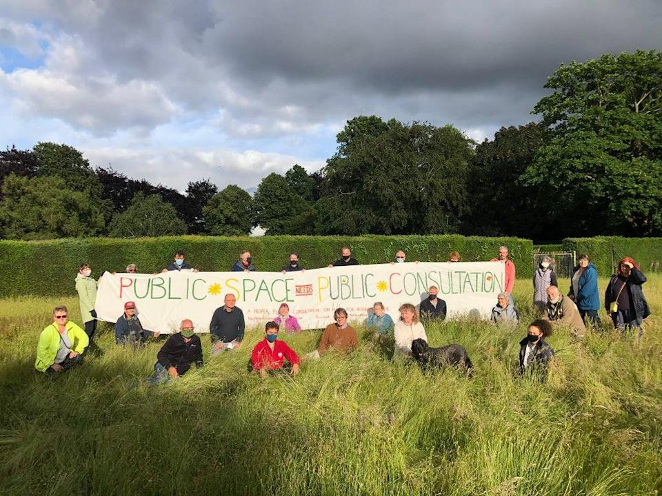 Protesters assemble at the meadow in Heigham Park in July (Lucy Galvin)