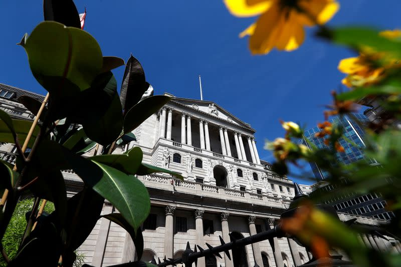 Flowers in bloom are sen opposite the Bank of England, in London