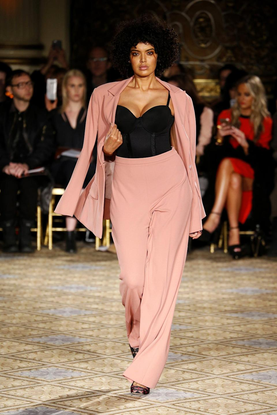 <p>London-born Saffi Karina has been defying industry standards since a former manager demanded she lose weight and she refused to do so, leaving that agency and joining IMG Models. Now, Karina can be seen in campaigns for L'Oréal and H&amp;M and has walked in a few of Christian Siriano's Fashion Week shows.</p>