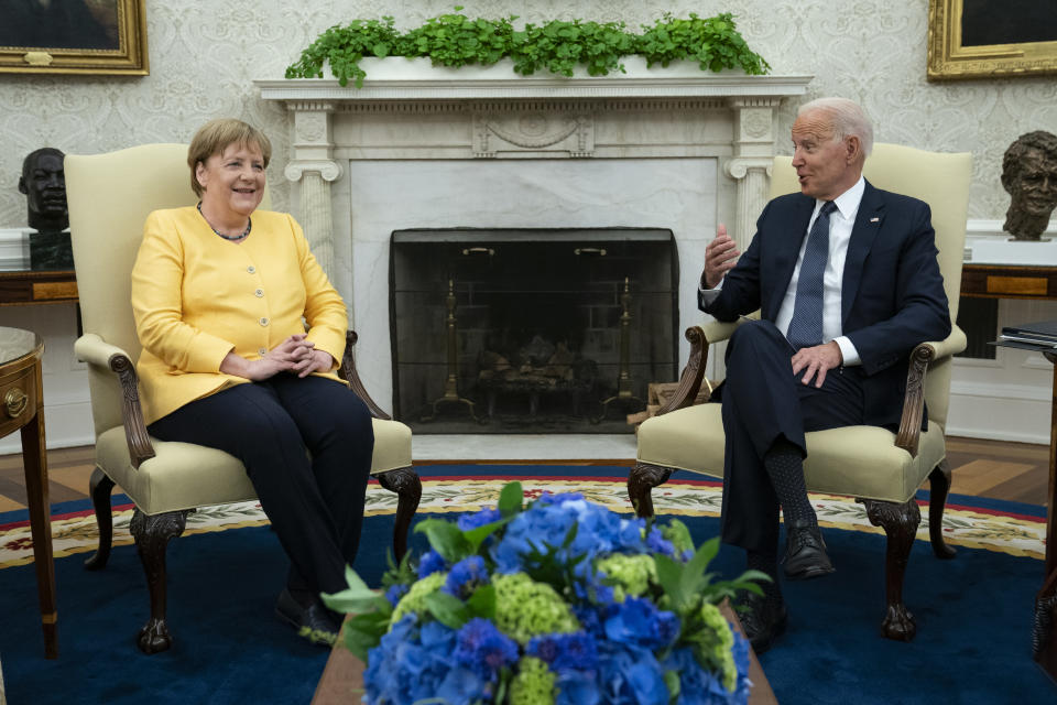 FILE - In this Thursday, July 15, 2021 file photo, U.S. President Joe Biden meets with German Chancellor Angela Merkel in the Oval Office of the White House in Washington. When U.S. President Joe Biden took office early this year, Western allies were falling over themselves to welcome and praise him and hail a new era in trans-Atlantic cooperation. The collapse of Kabul certainly put a stop to that. Even some of his biggest fans are now churning out criticism. (AP Photo/Evan Vucci, File)