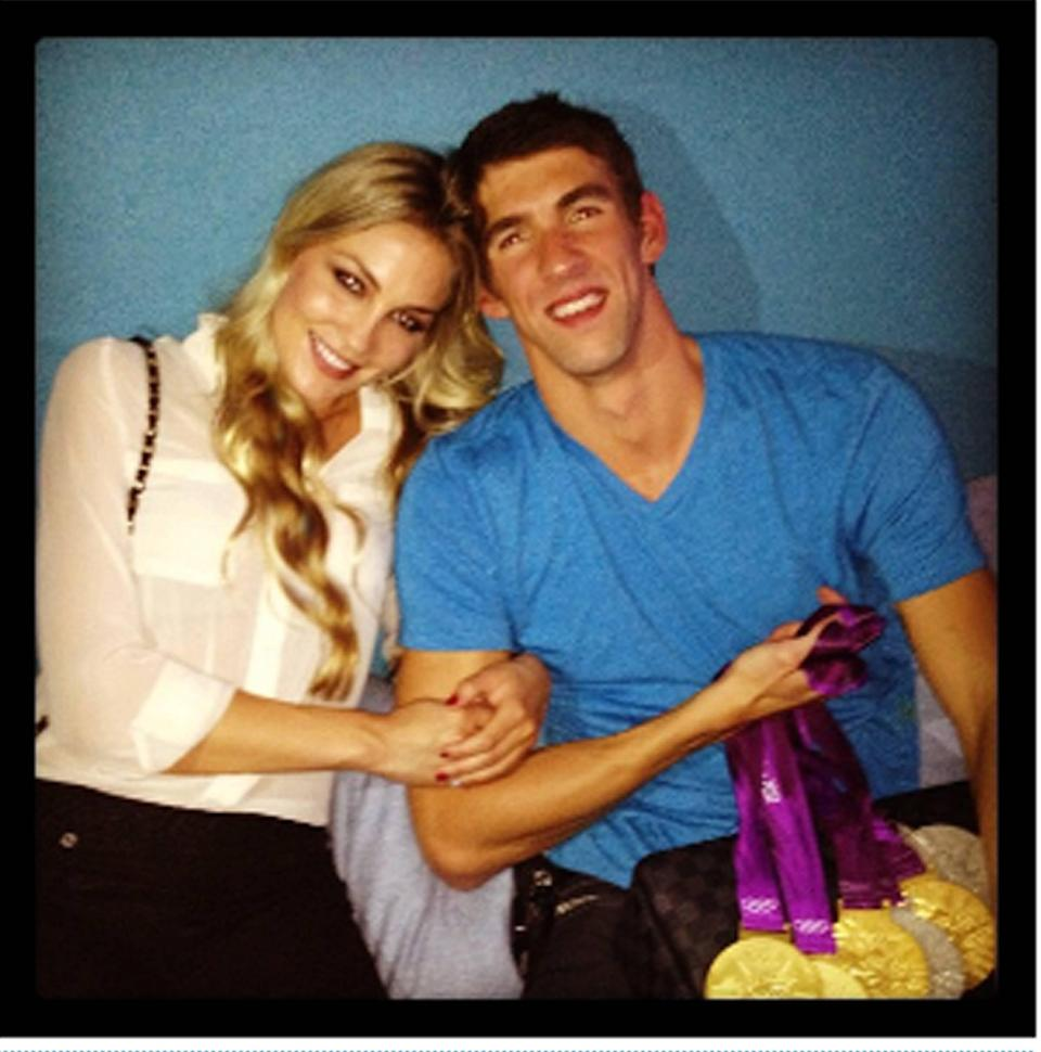 Megan Rossee tweets this image of herself and Michael Phelps