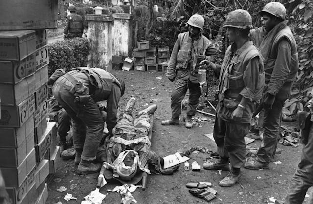 <p>A wounded American soldier being attended to on February 19, 1968 during the Vietnam war. (Photo: Terry Fincher/Daily Express/Hulton Archive/Getty Images) </p>