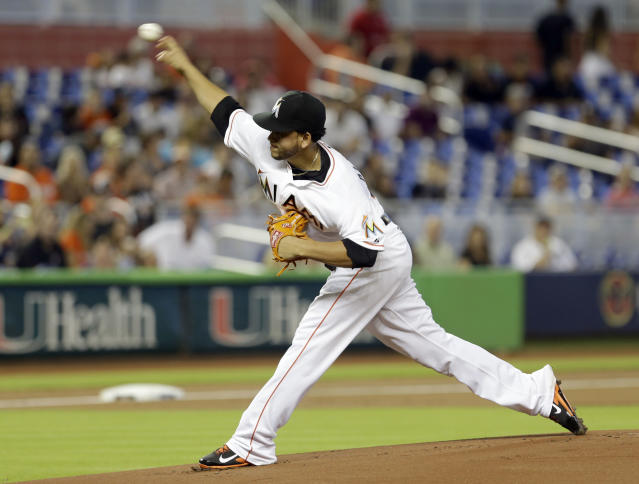 Miami Marlins' Henderson Alvarez pitches against the Miami Marlins in the first inning of an interleague baseball game, Sunday, Sept. 29, 2013, in Miami. (AP Photo/Alan Diaz)