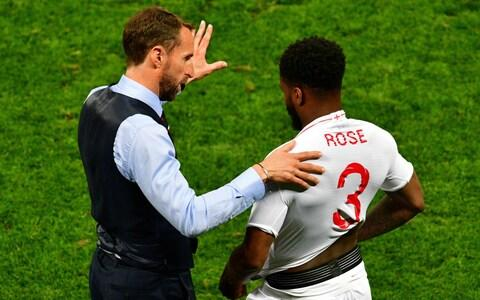 England's coach Gareth Southgate (L) speaks to England's defender Danny Rose during the Russia 2018 World Cup semi-final football match between Croatia and England at the Luzhniki Stadium in Moscow - Credit: AFP