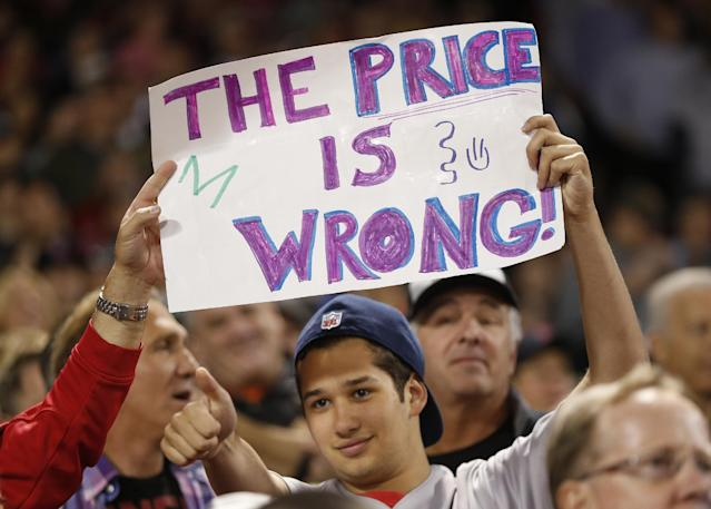 A Boston Red Sox fan holds a sign commenting on Tampa Bay Rays starting pitcher David Price in the eighth inning in Game 2 of baseball's American League division series Saturday, Oct. 5, 2013, in Boston. The Red Sox won 7-4. (AP Photo/Michael Dwyer)