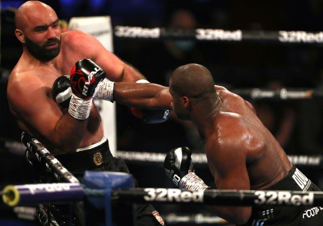 Daniel Dubois (right) delivers the knockout punch to Bogdan Dinu
