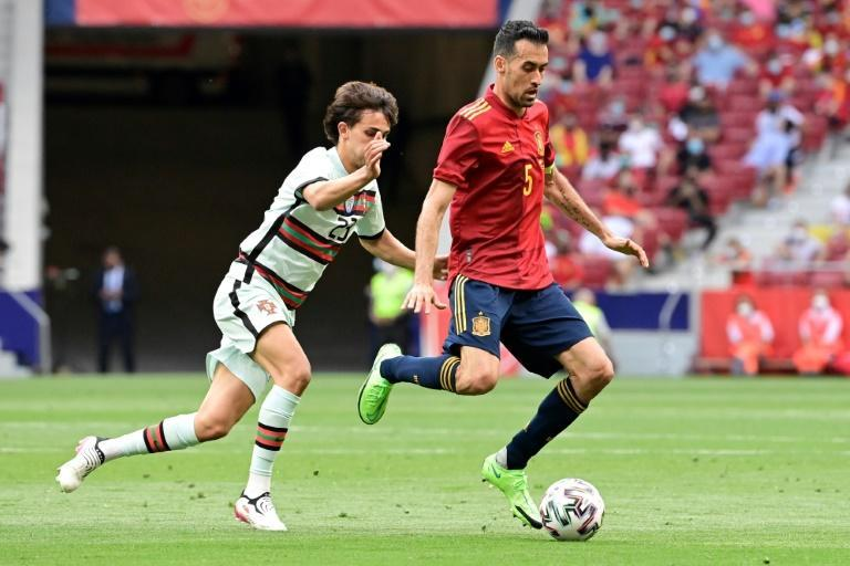 Spain's preparations were dealt a major blow when captain Sergio Busquets (R) tested positive for Covid-19 on Sunday