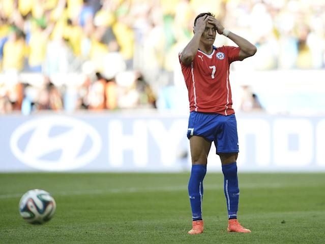 Chile's Alexis Sanchez reacts after his shot was stopped during a penalty shootout after regulation time during the World Cup round of 16 soccer match between Brazil and Chile at the Mineirao Stadium in Belo Horizonte, Brazil, Saturday, June 28, 2014. Brazil won 3-2 on penalties after a 1-1 tie. (AP Photo/Manu Fernandez)