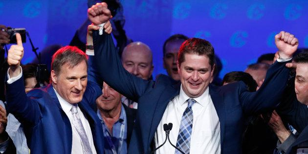 Maxime Bernier celebrates with Andrew Scheer after Scheer's Conservative Party of Canada leadership convention win in Toronto on May 27, 2017.