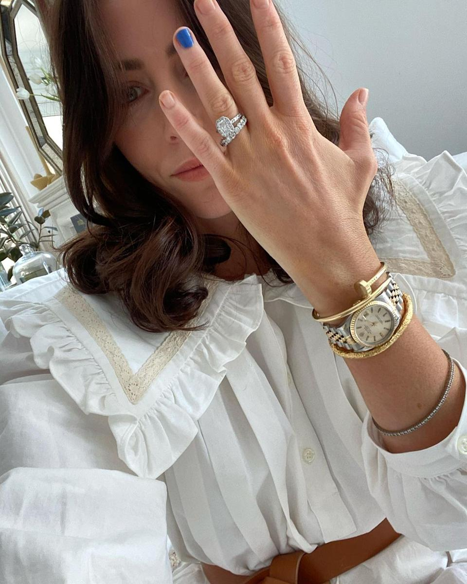 Nova 9.69 radio host Michael 'Wippa' Wipfli's wife Lisa holding up her hand to display her diamond engagement ring